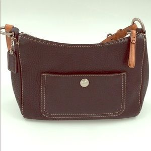 Black Coach purse with brown handles